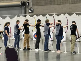 Ready, aim, the Knox Central archers are shown getting ready to shoot.