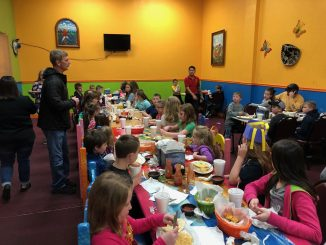 Students are shown enjoying a meal at 2 Amigos for placing in the top 5 on the i-Ready winter test.