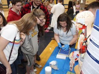 Students shown engaged at an exhibit during Knox Central's Career Pathway Showcase