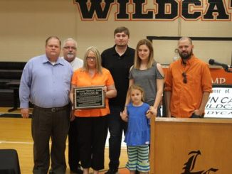 Jones family shown with plaque naming Lynn Camp gym after Richard Jones, long time coach.