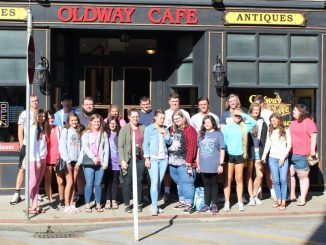 Knox Central Green Leaf students pose in front of Old Way Cafe.