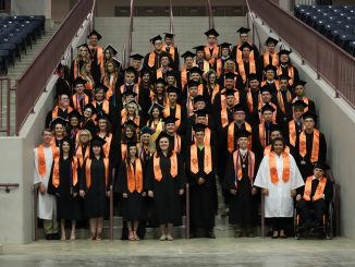 Lynn Camp Class of 2019 poses on the stairs at The Arena before graduation