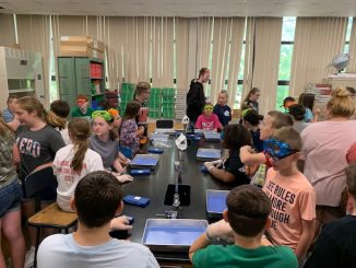 Students are shown in the science lab at Knox Middle to begin dissecting a shark.