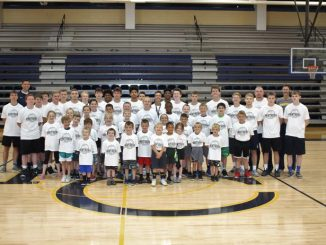 Attendees of the Future Panther Basketball Camp pose for a group photo on the last day of training.
