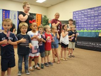 Students from Central Elementary line up to recite the Pledge at the August Board meeting.