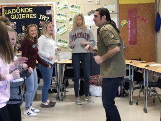 Yani Vozos is shown teaching students a Latino dance.