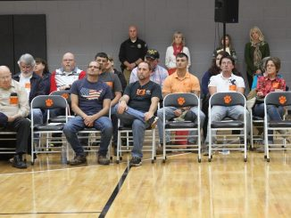 Veterans are shown seated at Lynn Camp.