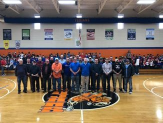 Veterans posed for a photo center court in the gym at Lay Elementary.
