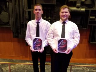 Two male winners from All State with plaques.