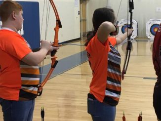 Two Lynn Camp archers ready to release arrows.