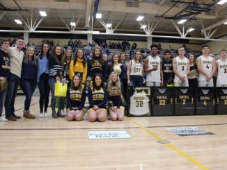 All students shown lined up with awards from senior night.