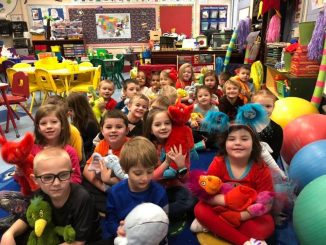 Students were siurrounded by their Seuss stuffed friends for readng time.