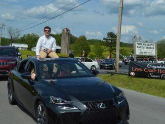 Lynn Camp senior shown on top of car beginning the celebration parade.