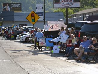 Photo of people lining the parade route in downtown.
