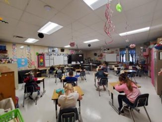 Students are shown socially distanced on the first day of school at Lynn Camp