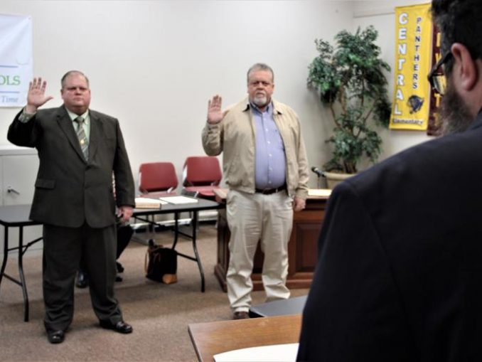 Board members Jimmy Hendrickson and Jim Miles are shown taking the Oath of Office by Honorable Judge Skip Hammons.