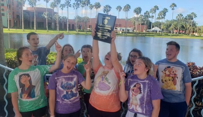 Lynn Camp Beta Club members are all smiles as they hold up their 7th place national plaque.