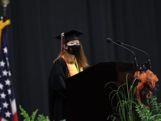 Amara Lewis presents a speech during Lynn Camp's commencement.