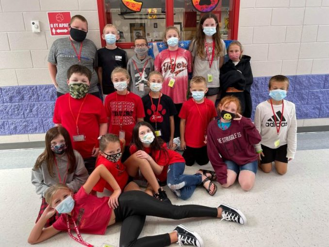 Students dressed in their red, black, and Tiger apparel are shown as part of school spirit day.